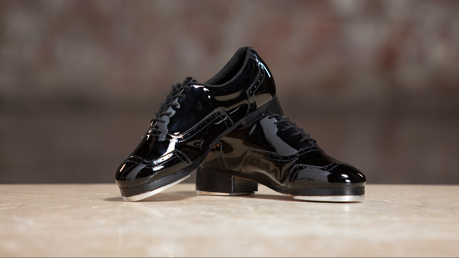 Tap to the beat in style with the Jason Samuels Smith Black Patent Tap Shoe!